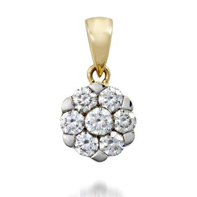 Dije en oro amarillo de 18 Kilates con 7 diamantes de 0.30 Ct Peso total.