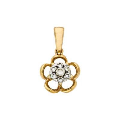 Dije en oro amarillo de 18 Kilates con 7 diamantes de 0.15 Ct peso total.