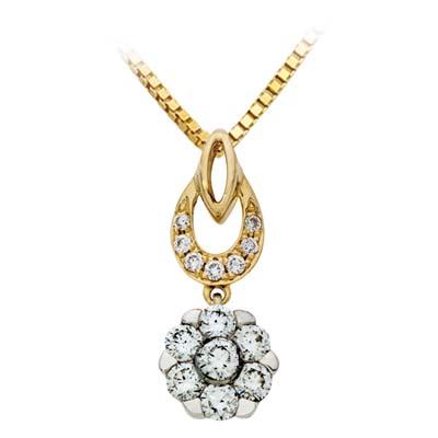 Dije en oro amarillo de 18 Kilates con 14 diamantes de 0.35 Ct peso total.