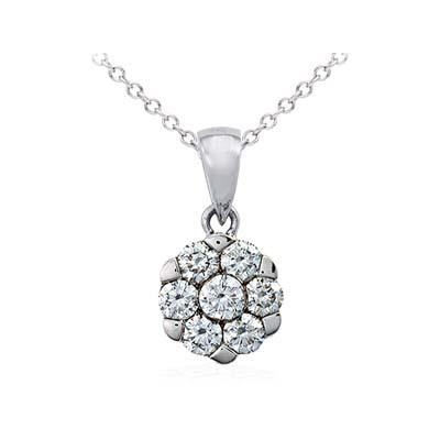 Dije en oro blanco de 18 Kilates con 7 diamantes de 0.20 Ct peso total, de la colección flores para ti.