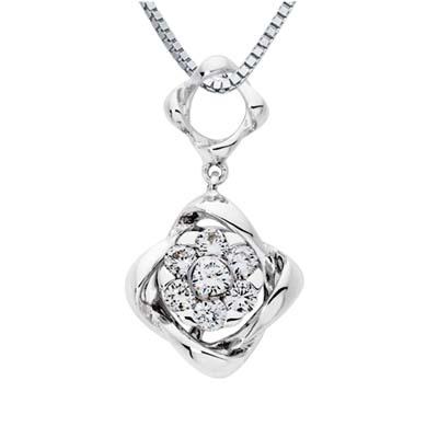 Dije en oro blanco de 18 Kilates con 7 diamantes de 0.25 Ct Peso total de la colección Flores para ti.