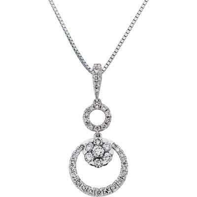 Dije en oro blanco de 18 Kilates con 41 diamantes de 0.45 Ct peso total de la colección Flores para ti.