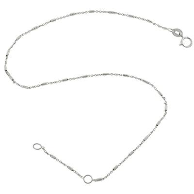 Tobillera en oro blanco de 18 Kilates visos, tejido rolo, barras con visos, 0.5 milímetros de ancho, 25 centímetros de largo.