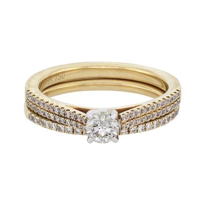 Set de matrimonio en oro amarillo de 18 Kilates con diamante central de 0.25 Ct y diamantes en decoración de 0.28Ct peso total.
