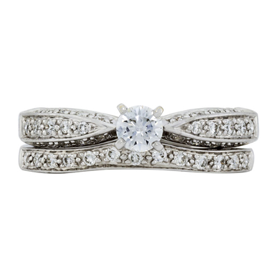 Set matrimonio en oro blanco de 18 Kilates rodinado con diamantes en decoracion de 0.31Ct peso total, 2 milímetros de ancho