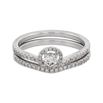Set de matrimonio en oro blanco de 18 Kilates con diamante central de 0.20 Ct y diamantes en decoración de 0.30 Ct Peso total.