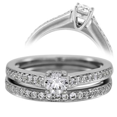 Set de matrimonio en oro blanco de 18 Kilates con diamante central de 0.25 Ct y diamantes en decoración de 0.27 Ct Peso total.