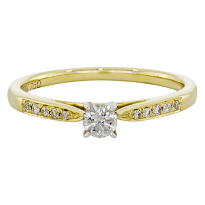 Anillo compromiso en oro amarillo de 18 Kilates con diamante central de 0.15Ct