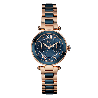 Reloj Guess colection analogo, para Dama, tablero redondo color azul, estilo puntos + romano, pulso metalico color plateado, calendario