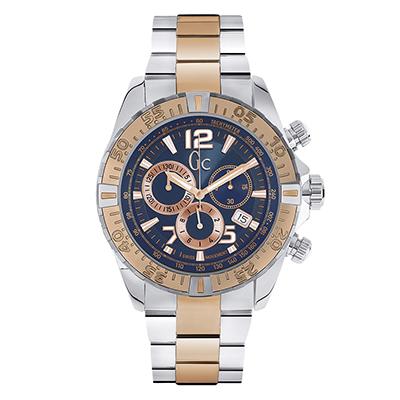 Reloj Guess colection analogo, para Hombre, tablero redondo color azul, estilo index + arabigo, pulso metalico color plateado, calendario