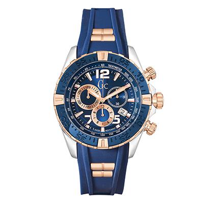 Reloj Guess colection analogo, para Hombre, tablero redondo color azul, estilo index + arabigo, pulso silicona color azul, calendario