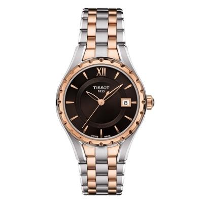 TISSOT LADY QUARTZ,  Reloj para dama,  Pulso metalico bicolor, Cristal de Zafiro, Calendario.